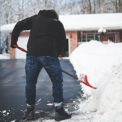 man snow shovel image local lawn care company website london ontario